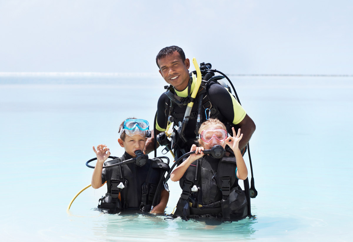 Kids learning to scuba dive