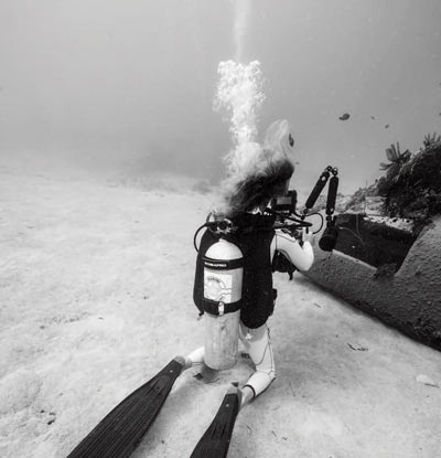 Diver sitting in sand